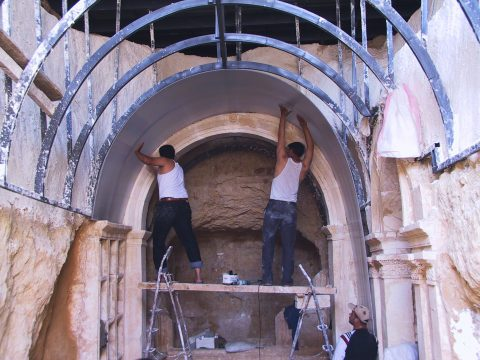 Restoring two underground tombs